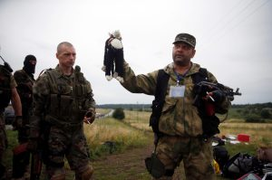 A pro-Russian separatist holds a stuffed toy found at the crash site of Malaysia Airlines flight MH17, near the settlement of Grabovo in the Donetsk region