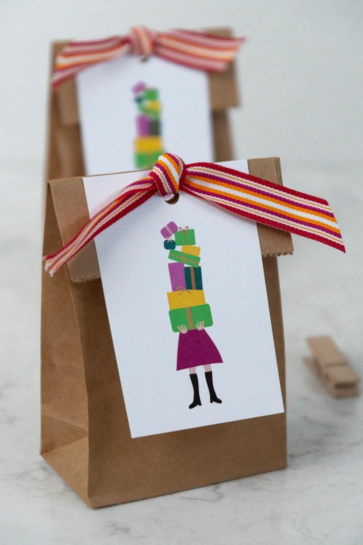 Girl Holding a Tower of Gifts Tags