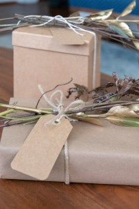Spray paint branches for fall gift wrap