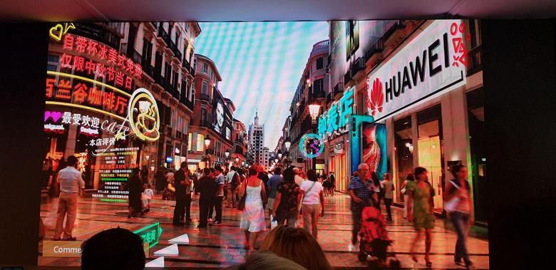 imagen de cómo se vería el sistema en pantalla mostrando letras flotando en la imagen captada por la cámara.