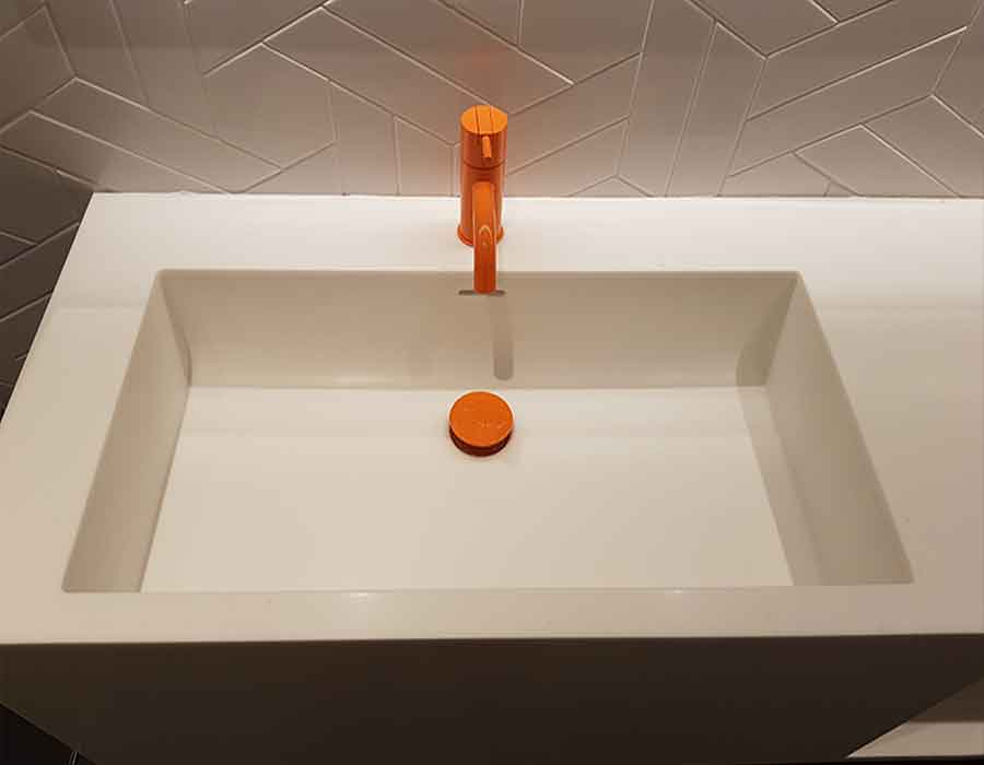 Custom-made-sink-with-orange-tap