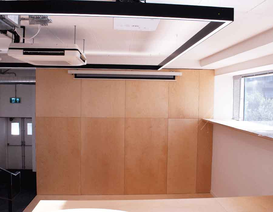 bespoke-projector-wall-and-wood-bleacher-seating