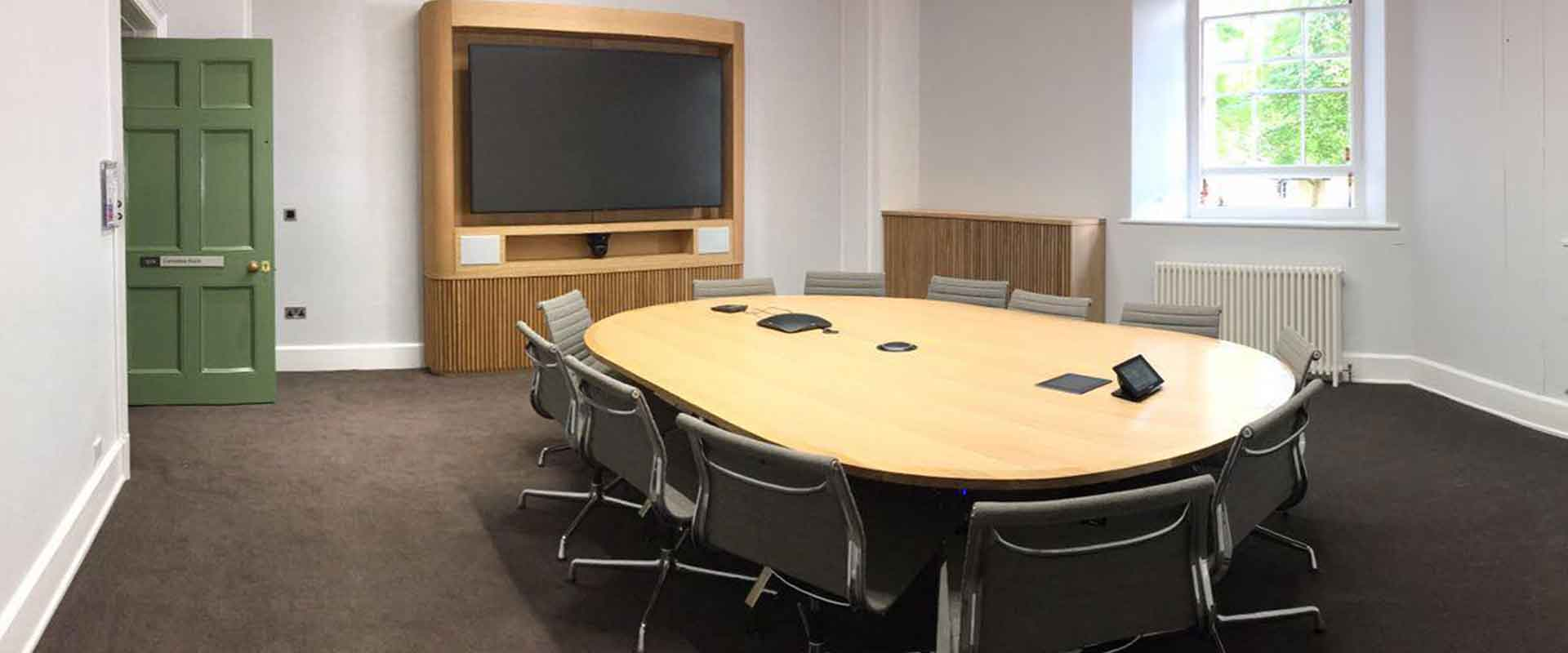 UCL-conference-room-with-meeting-room-table-and-media-unit