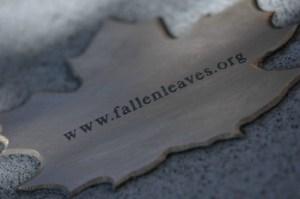 bronze leaf reading 'fallenleaves..org'