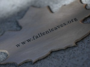 bronze leaf reading 'fallenleaves..org'