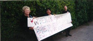 Colette Fleming (far left) standing with Women in Black