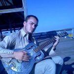 Myles Carroll with guitar