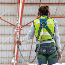 woman wearing fall protection harness