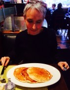 Sue contemplating 3 giant pancakes