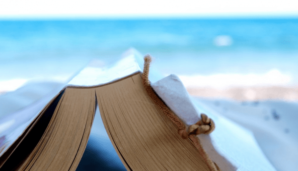 Reading_a_book_at_the_beach___Flickr_-_Photo_Sharing_