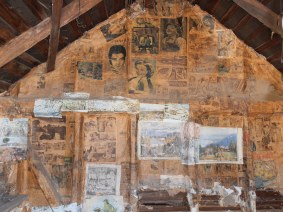 Newspapers lining the walls of Pendergast Hut