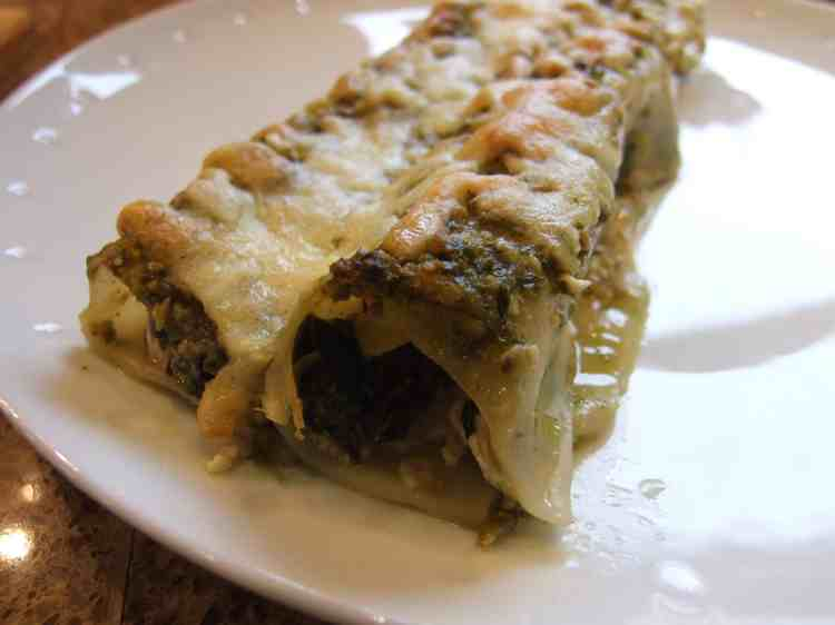 Spinach lasagne rolls on a plate