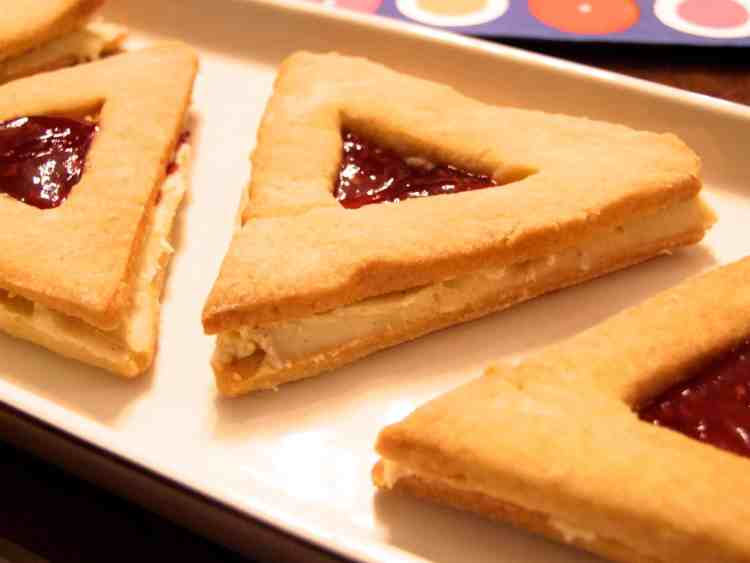 white chocolate & raspberry hamantaschen sandwich cookies