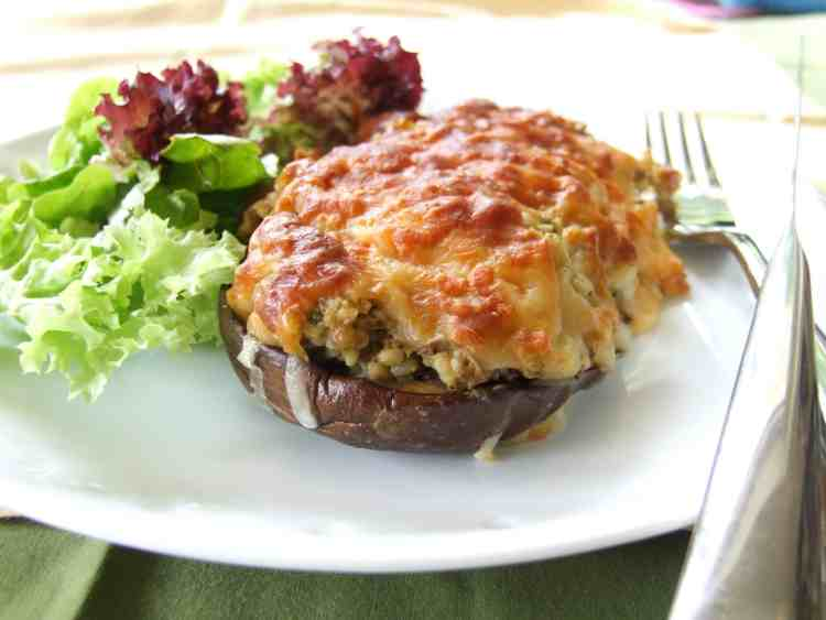 Tender aubergines, filled with a rich, pesto-infused bulgar wheat stuffing and topped with a layer of golden, melty cheese. A favourite vegetarian dinner.