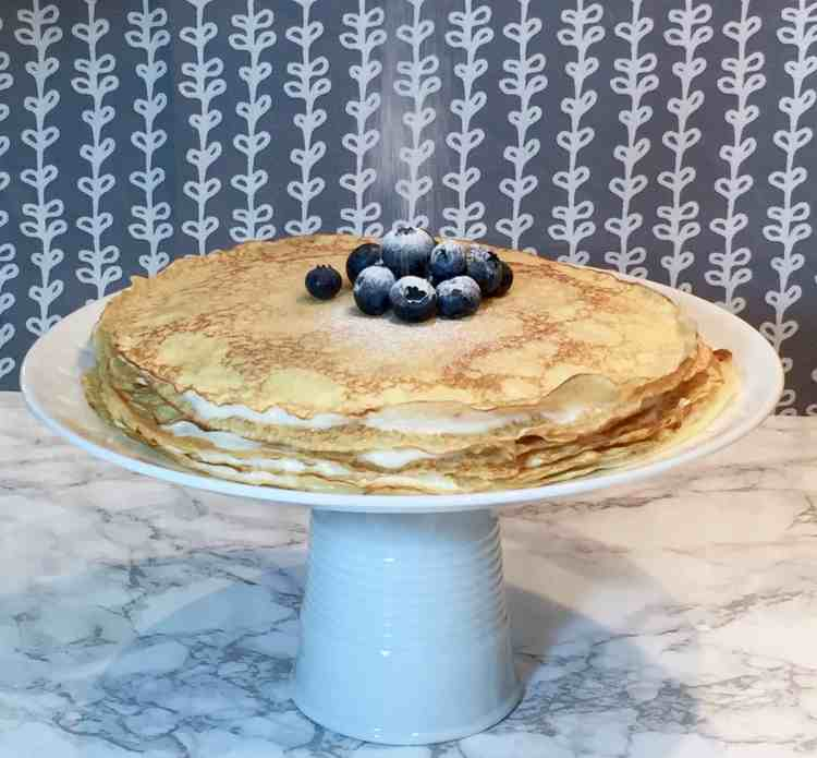 Traditional cheese blintzes are given a makeover & assembled into this beautiful & delicious crepe cake. Perfect with fresh fruit for a springtime dessert.