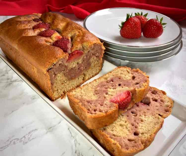 strawberry banana bread. Fresh strawberries turn this moist & fruity banana loaf cake into a zingy seasonal treat! Delicious as a snack or with ice-cream as an easy dessert.