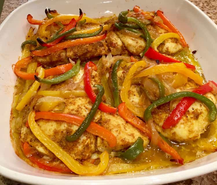Succulent baked fish and sweet, juicy peppers combine in this easy one-dish family meal. Serve with rice for a delicious dinner that everyone will enjoy.