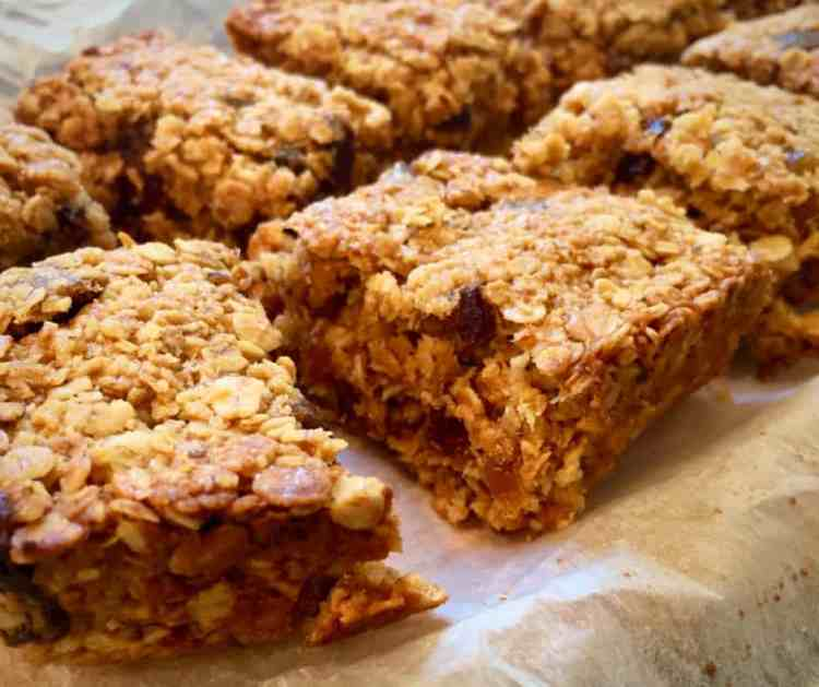 Squidgy coconut and date flapjacks are a delicious twist on a British tea-time treat, packed with oats and dried fruit, and flavoured with rich date syrup and a pinch of spice.