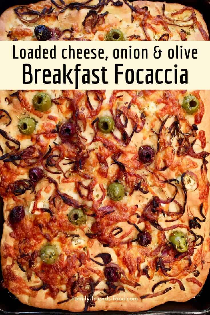 Loaded cheesy breakfast focaccia tops fluffy home-made Italian bread with caramelised onions, olives, herbs, and three different cheeses! It's a savoury morning treat.