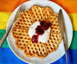 vegan Norwegian waffles with yogurt and strawberry jam.