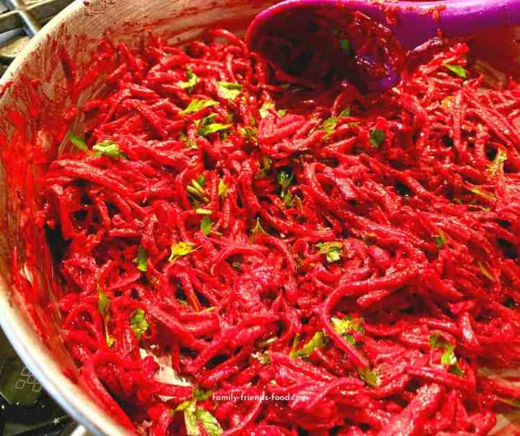 Grated beetroot in a pan.