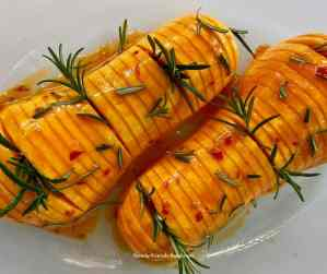 Uncooked hasselback butternut squash.