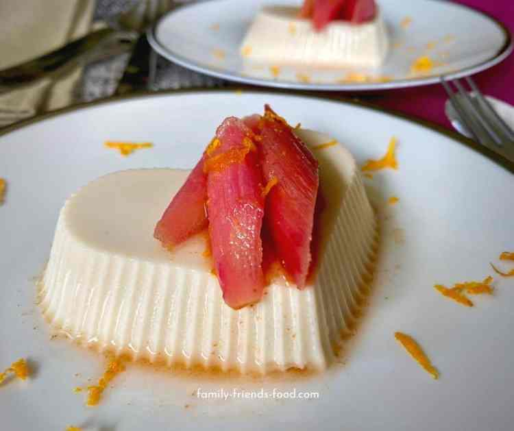 Vegan panna cotta with roasted rhubarb - close up.
