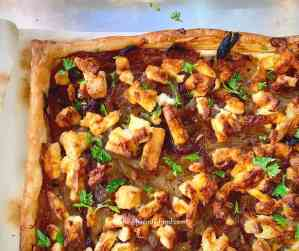 Corner of caramelised onion and feta tart.