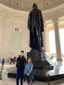 Sam and Sasha next to the statue of Thomas Jefferson