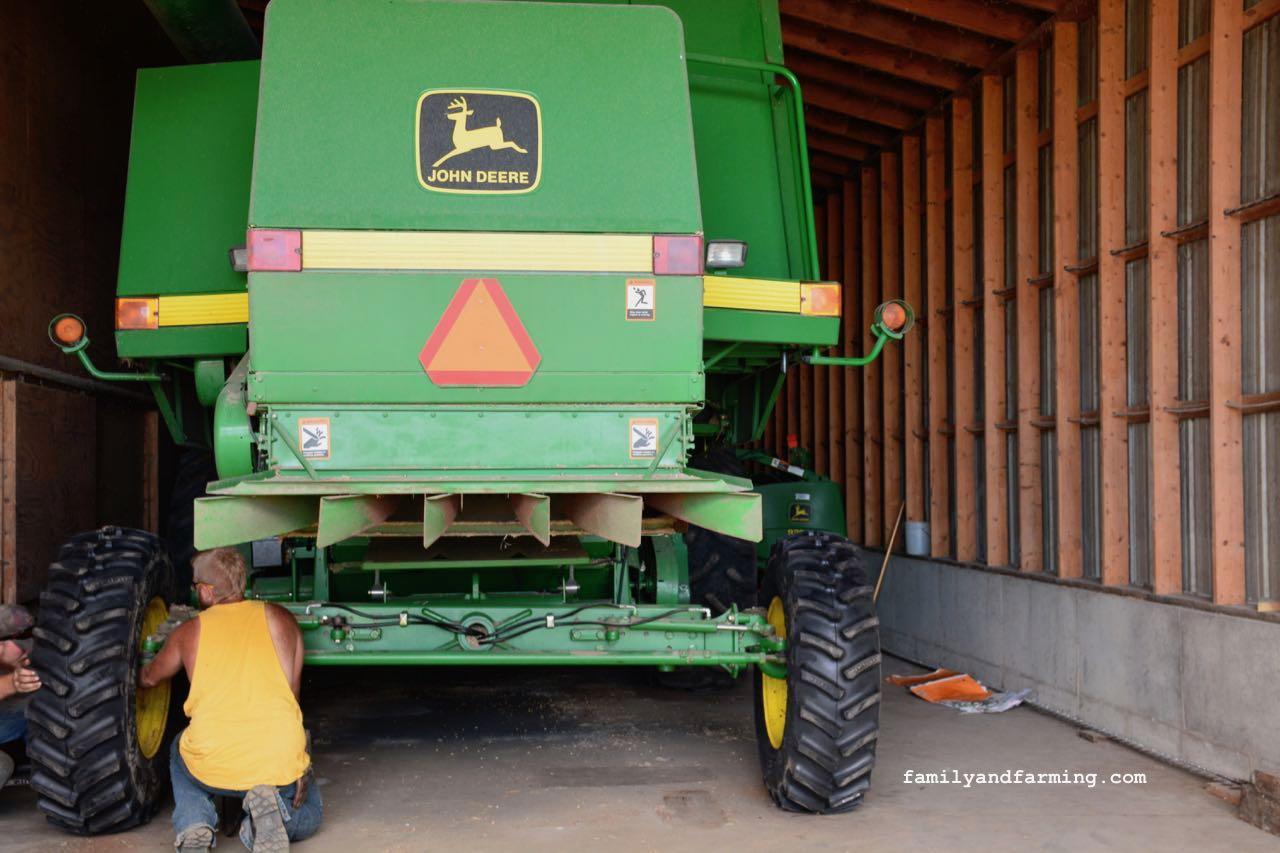 Changing tires on combine