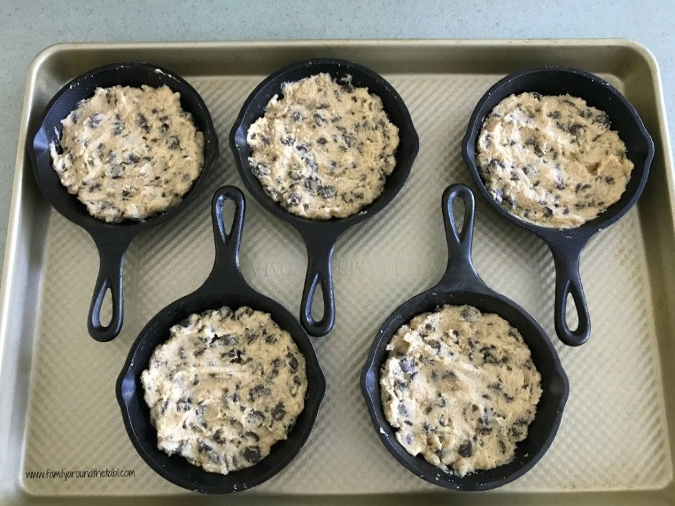 Individual chocolate chip cookie skillets ready for the oven.