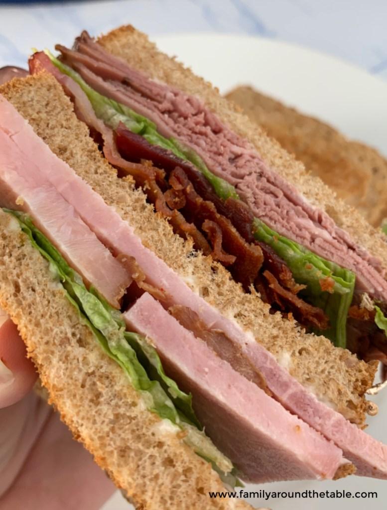 A close up of a club sandwich.