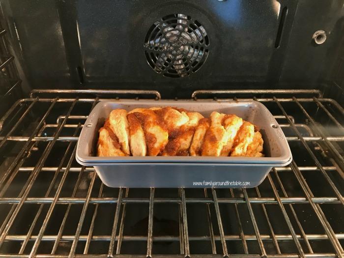 Easy pumpkin spice pull-apart bread with cinnamon vanilla glaze in the oven.