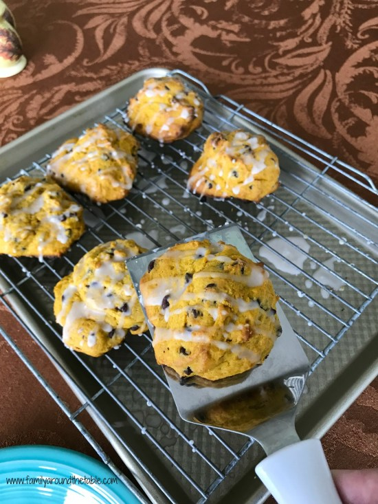 Glazed pumpkin chocolate chip scones are a drop scone. Full of delicious pumpkin flavor with a touch of sweet from mini chocolate chips and glaze. #PumpkinWeek