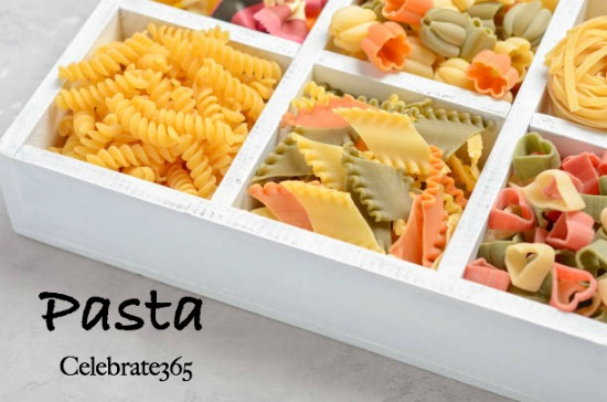 Variety of types and shapes of raw Italian pasta. Pasta with Celebrate365