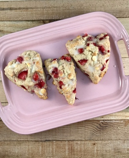 White chocolate, strawberry and champagne scones with champagne glaze are perfect for a spring brunch. Serve with a glass of bubbly or cup of coffee.