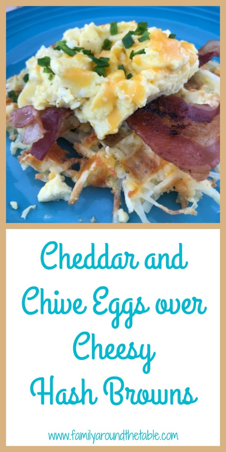 A hearty breakfast of Cheddar and chive eggs over cheesy hash brown waffles.