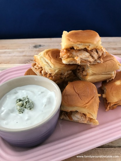 Easy Buffalo chicken sliders with homemade blue cheese dressing is great for tailgate or game day parties.