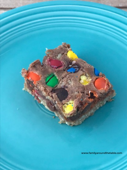 One Chocolate Chip M&M Bar on a blue plate.