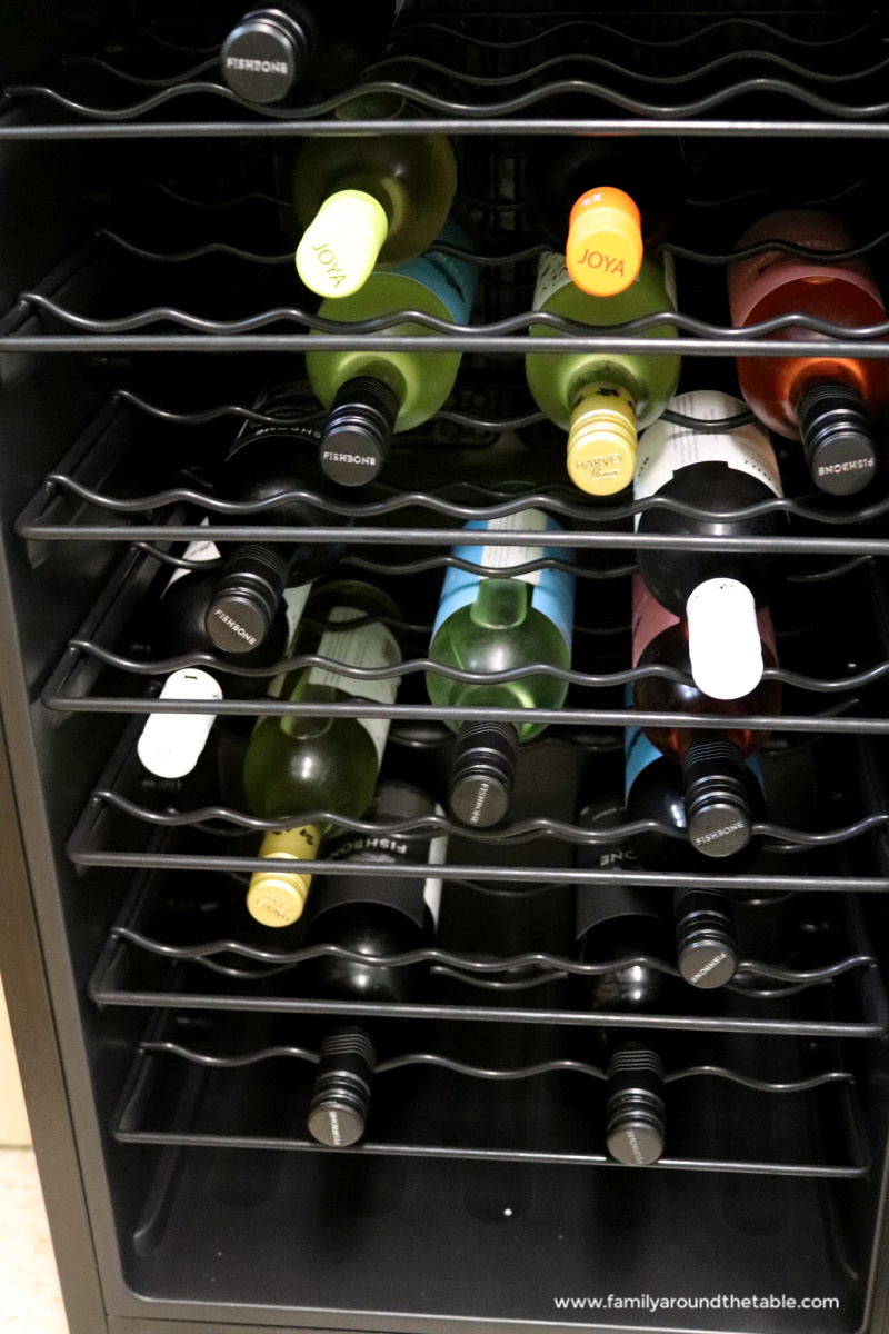 Wine bottles in a wine refrigerator.