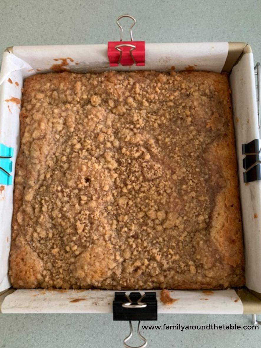 Baked snickerdoodle crumb cake in pan.
