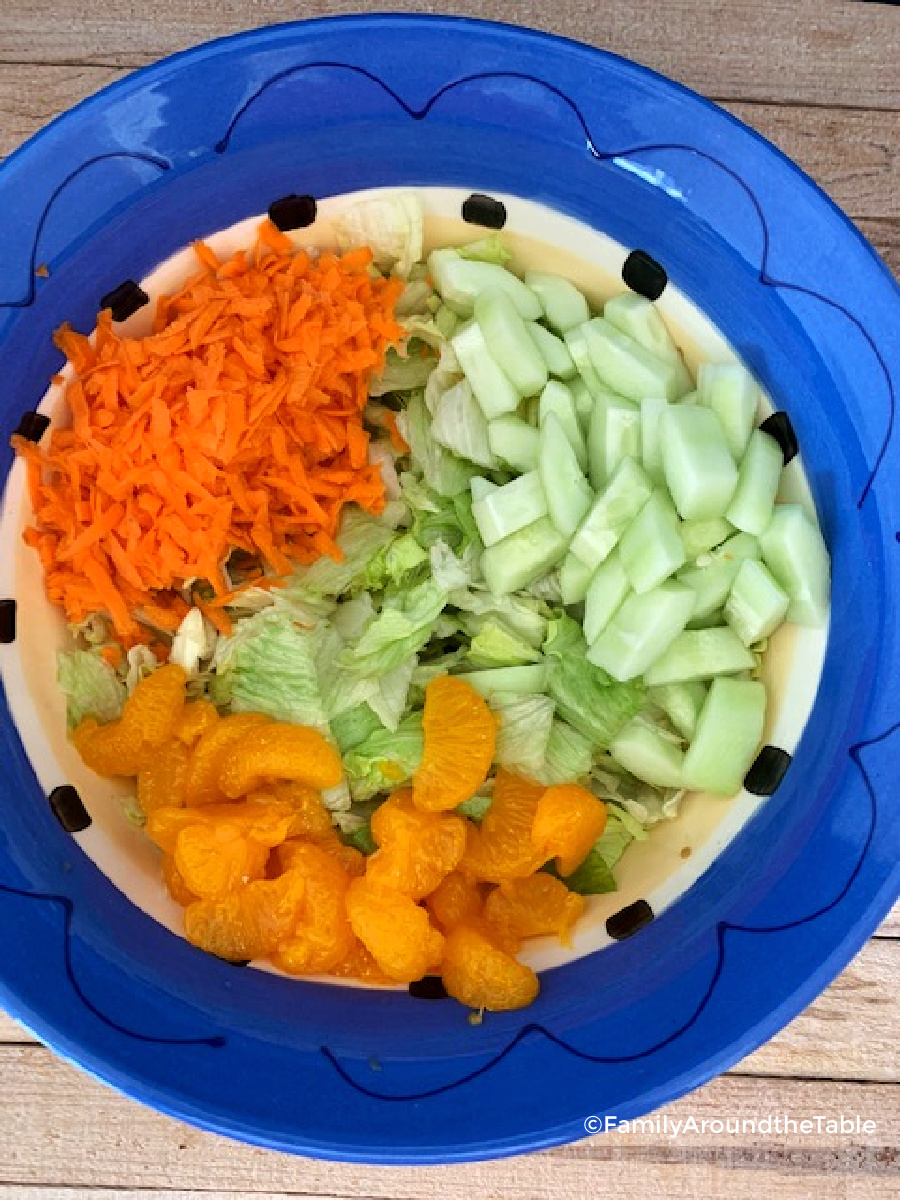 Overhead photo of salad in a colorful bowl.
