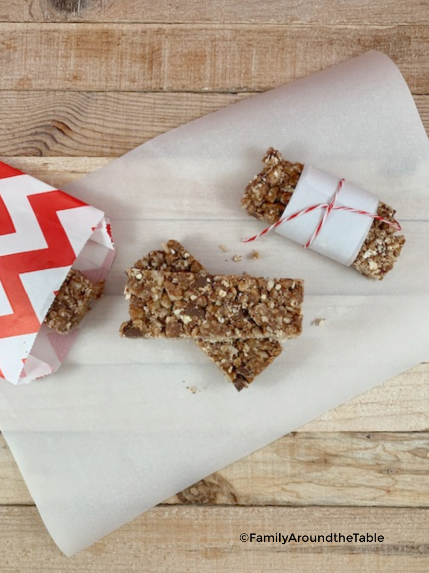 Overhead photos of multiple chocolate chip pecan granola bars.