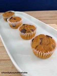 Pumpkin Chocolate Chip Muffins on a white platter.