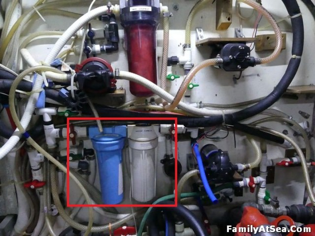 Engine room plumbing panel, the two house filters are circled in red.