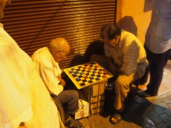 Playing chess...notice they use the lids from pop bottles