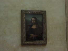 Noah squirmed to front to get a good shot of the Mona Lisa