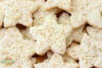 Holiday Star Cookies are bright, buttery & sparkly. They're perfect for the holidays! Candy coated & sprinkled to holiday perfection, everyone loves these melt-in-your mouth vanilla shortbread cookies.