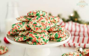 Christmas Sprinkle Cookies are sugar Cookies rolled in Christmas sprinkles for a special holiday treat! Delightfully soft & chewy Christmas cookies made with festive holiday sprinkles!