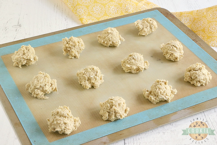 Placing oatmeal cookie dough balls on cookie sheet